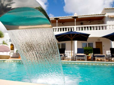Poolside water feature at Case Monte Cristo luxury apartments, Praia de Luz, Algarve, Portugal