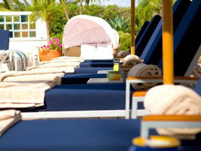 Sun loungers at Case Monte Cristo apartments' swimming pool, Algarve, Portugal