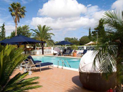 Sunbath by the pool at Casa Monte Cristo luxury apartments, Algarve, Portugal